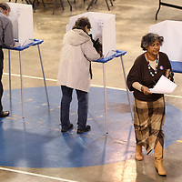 Damita Tucker, of Tupelo, walks to turn in her ballot after casting her vote Tuesday morning at Bissell Baptist Church.