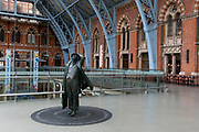 As the UK government urged that all Britons should avoid non-essential travel abroad in order to combat the Coronavirus pandemic in Britain, the statue of poet John Betjeman (2007) by Martin Jennings looks across an empty upper concourse at St. Pancras rail station, the London terminus for Eurostar services to mainland Europe, on 17th March 2020, in London, England.