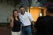 Oscar De La Hoya takes a photo with a fan outside AT&T Stadium in Arlington, Texas before heading back to the hotel at the end of the night on September 16, 2016.  (Cooper Neill for ESPN)