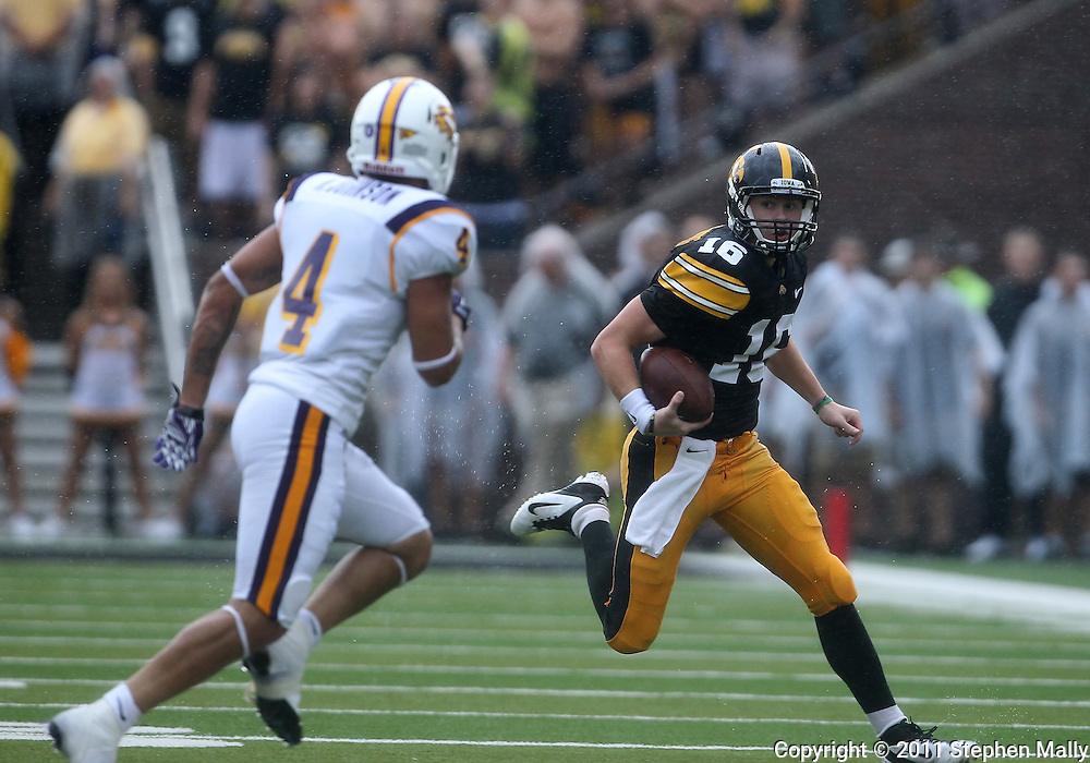 September 3, 2011: Iowa Hawkeyes quarterback James Vandenberg (16) eyes Tennessee Tech Golden Eagles cornerback Will Johnson (4) as he scrambles for yards during the first half of the game between the Tennessee Tech Golden Eagles and the Iowa Hawkeyes at Kinnick Stadium in Iowa City, Iowa on Saturday, September 3, 2011. Iowa defeated Tennessee Tech 34-7 in a game stopped at one point due to lightning and rain.