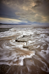 I tend to follow bad weather when looking for landscape images. This night led me to Bridgwater Bay. The rising tide encroaching onto the Jurassic limestone beds at Lilstock beach formed the perfect turbulent counterpoint to the lowering skies.