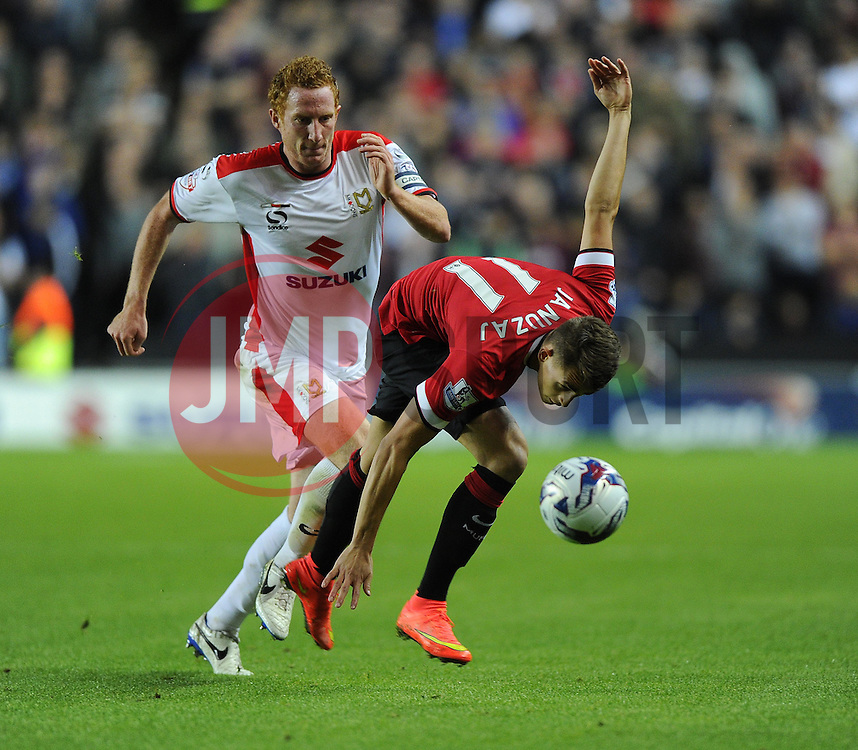 Milton Keynes Dons' Dean Lewington battles for the ball with Manchester United's Adnan Januzaj - Photo mandatory by-line: Joe Meredith/JMP - Mobile: 07966 386802 26/08/2014 - SPORT - FOOTBALL - Milton Keynes - Stadium MK - Milton Keynes Dons v Manchester United - Capital One Cup