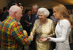 File photo dated 4/6/12 of Queen Elizabeth II meeting Madness and Kylie Minogue backstage at The Diamond Jubilee Concert outside Buckingham Palace, London. The pop star and actress turns 50 on Monday.