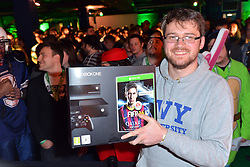 © Licensed to London News Pictures. 21/11/2013, UK. Charlie Pulbrook - first person to purchase the new XBOX ONE at it's launch in London, Trocadero, London, 21 November 2013. Photo credit : Richard See Li/Piqtured/LNP