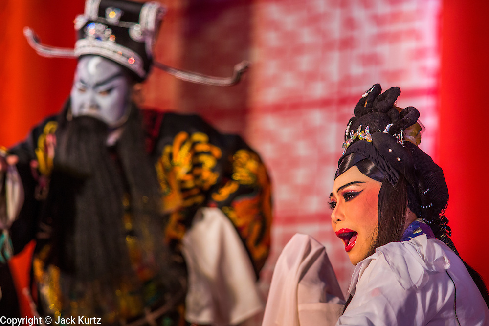 08 FEBRUARY 2013 - BANGKOK, THAILAND: A Chinese opera performance for Chinese New Year at Seacon Square in Bangkok. Chinese opera is popular in Thailand and is usually performed in the Teochew language. The weeks surrounding Chinese New Year are important for retailers in Thailand and many malls put on special promotions and events honoring Chinese culture, like Lion Dances or Chinese Opera. Thailand has a large Thai-Chinese population. Millions of Chinese emigrated to Thailand (then Siam) in the 18th and 19th centuries and brought their cultural practices with them.    PHOTO BY JACK KURTZ