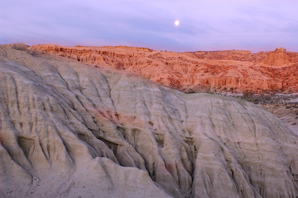 Full moon setting over Badlands at Red Rock Canyon State Park, Sunrise, California, United States of America