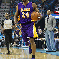 April 28, 2011; New Orleans, LA, USA; Los Angeles Lakers shooting guard Kobe Bryant (24) against the New Orleans Hornets during the first quarter in game six of the first round of the 2011 NBA playoffs at the New Orleans Arena.    Mandatory Credit: Derick E. Hingle