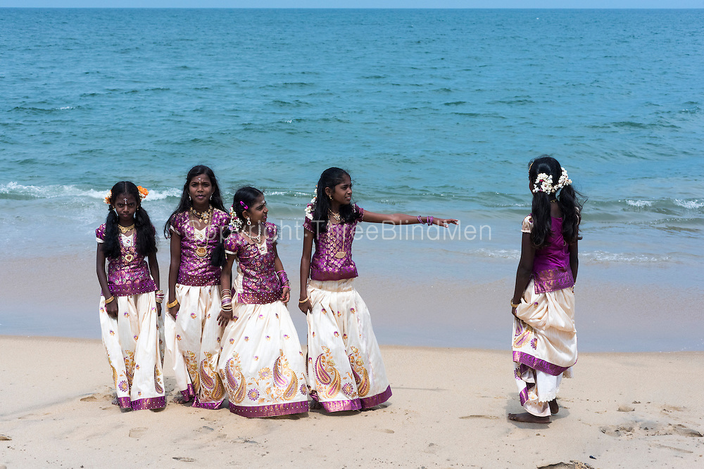 Children play on the beach before their final dance and ceremony on the beach at Udappu.