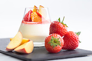 Limoncello flavoured panna cotta with peach coulis pictured at P&amp;O Cruises Development Kitchen for the Macmillan Cancer Support cookery book.<br /> Picture date: Friday April 29, 2016.<br /> Photograph by Christopher Ison &copy;<br /> 07544044177<br /> chris@christopherison.com<br /> www.christopherison.com