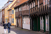 Tourists strolling along medieval street in Ribe centre, South Jutland, Denmark