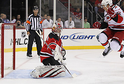 Oct 10; Newark, NJ, USA; New Jersey Devils goalie Johan Hedberg (1) makes a save through a screen by Carolina Hurricanes center Jeff Skinner (53) during the first period at the Prudential Center.