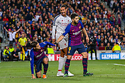 Liverpool defender Joel Matip (32) remonstrates with Barcelona midfielder Courtinho (7) who is helped up by Barcelona forward Luis Suárez (9) during the Champions League semi-final leg 1 of 2 match between Barcelona and Liverpool at Camp Nou, Barcelona, Spain on 1 May 2019.