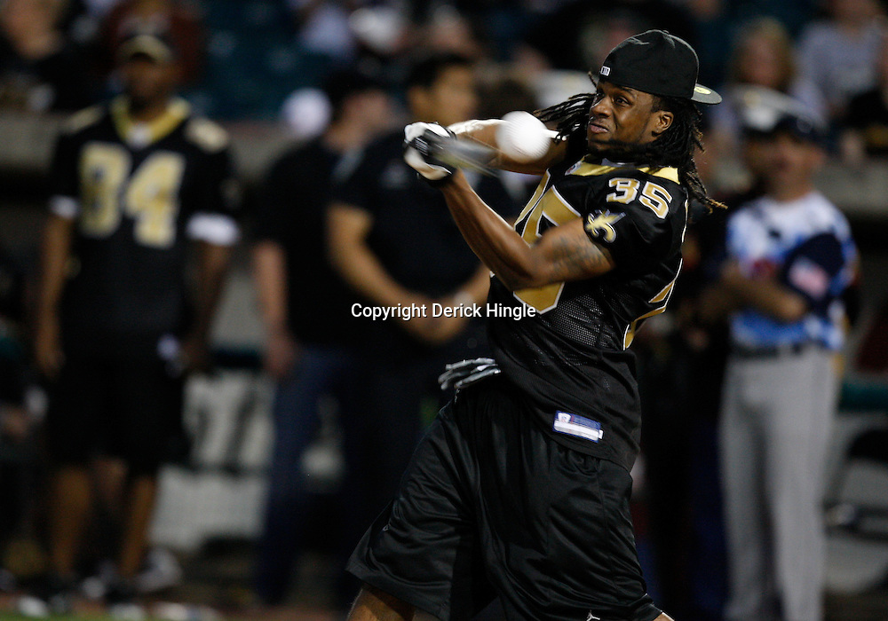 Apr 28, 2010; Metairie, LA, USA; Reggie Jones (35) at bat during the Heath Evans Foundation charity softball game featuring teammates of the Super Bowl XLIV Champion New Orleans Saints at Zephyrs Field.  Mandatory Credit: Derick E. Hingle-US-PRESSWIRE.