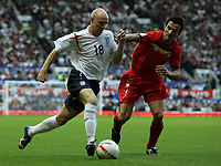 Photo: Paul Thomas.<br /> England v Andorra. European Championships 2008 Qualifying. 02/09/2006.<br /> <br /> Andy Johnson of England (L) goeas around  Jose Manuel Garcia.