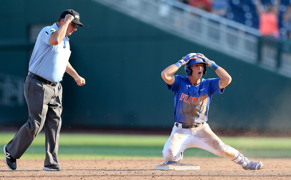 OMAHA, NEB.  -- 06/21/2016:   Florida's Jonathan India (6) reacts after being called out at second base to end the game and eliminate the Gator from the College World Series at TD Ameritrade Park in Omaha, Neb., Tuesday, June 21, 2016.<br /> MATT DIXON/THE WORLD-HERALD