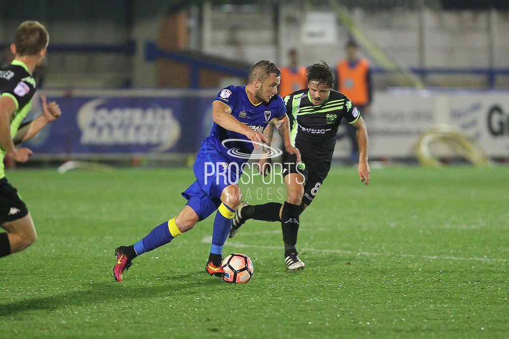 AFC Wimbledon midfielder Dean Parrett (18) during the The Emirates FA Cup 1st Round Replay match between AFC Wimbledon and Bury at the Cherry Red Records Stadium, Kingston, England on 15 November 2016. Photo by Stuart Butcher.