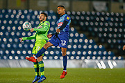 Wycombe Wanderers forward Paris Cowan-Hall(12) jumps with Norwich City midfielder Ben Marshall (7) during the EFL Cup match between Wycombe Wanderers and Norwich City at Adams Park, High Wycombe, England on 25 September 2018.