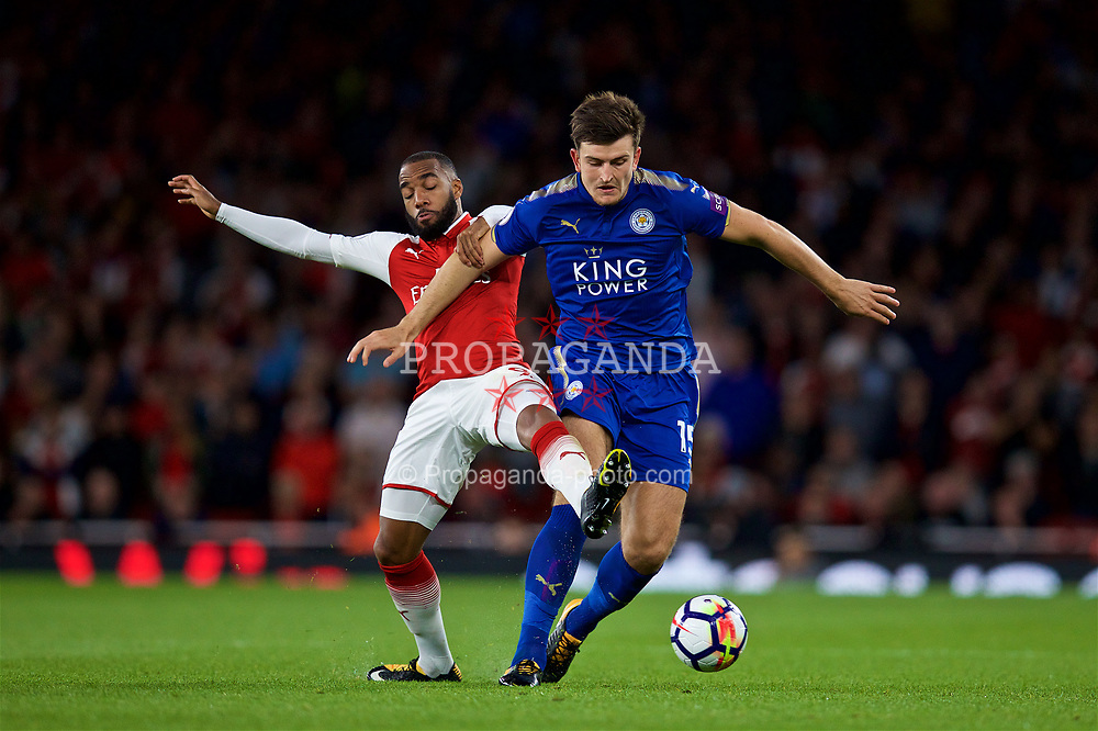LONDON, ENGLAND - Friday, August 11, 2017: Arsenal's Alexandre Lacazette and Leicester City's Harry Maguire during the FA Premier League match between Arsenal and Leicester City at the Emirates Stadium. (Pic by David Rawcliffe/Propaganda)