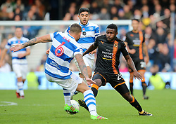 Wolves Connor Ronan (right) and QPR's Joel Lynch battle for the ball during the Sky Bet Championship match at Loftus Road, London.