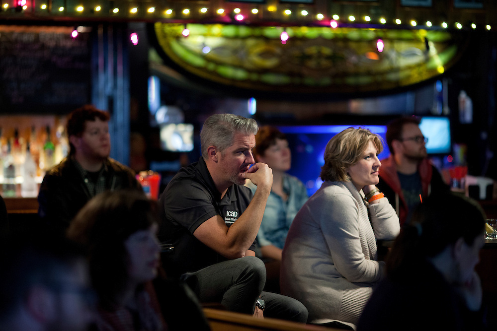 "Mark Nolte and DaLayne Williamson listen to a panel on the role of the audience in art and the process of creating work at the Mill restaurant in Iowa City, Iowa on Friday, November 6, 2015 during day one of the Witching Hour Festival. The new festival seeks to explore ""the unknown"" through performance and dialogue."