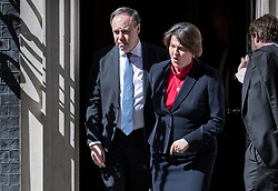© Licensed to London News Pictures. 02/07/2018. London, UK. DUP Leader Arlene Foster reacts to the bright sunshine in Downing Street as she walks from Number 10 with Nigel Dodds MP after talks with Prime Minister Theresa May. Photo credit: Peter Macdiarmid/LNP