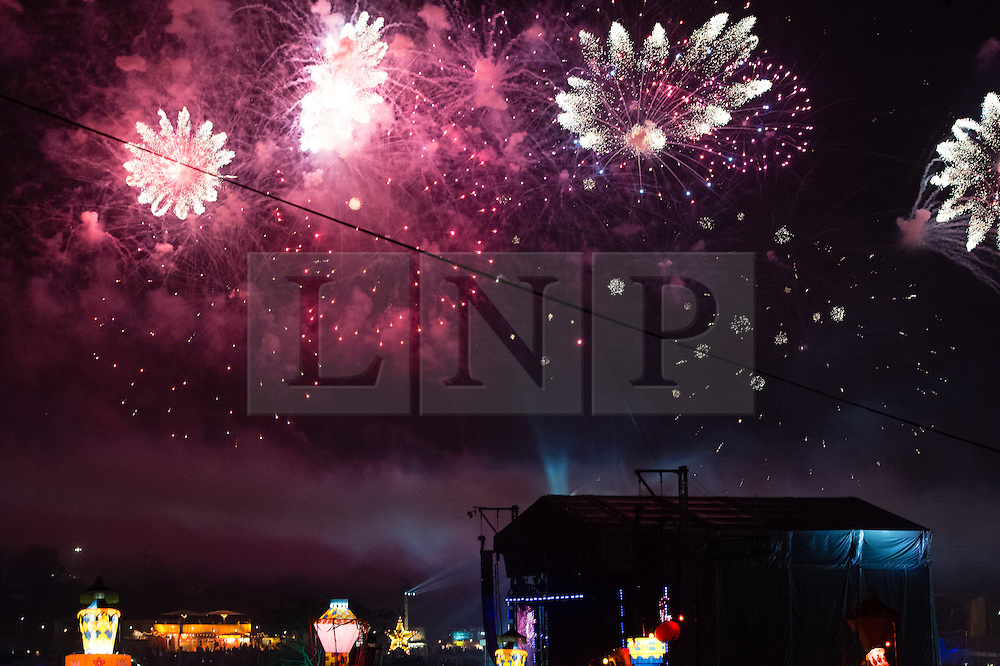 © Licensed to London News Pictures. 07/09/2014. Isle of Wight, UK. Bestival 2014 - the firework display over the main stage of Bestival  that signifies the end of the festival this year on Day 4 Sunday the final day of the festival. This weekend's headliners include Chic featuring Nile Rodgers, Foals and Outcast.   Bestival is a four-day music festival held at the Robin Hill country park on the Isle of Wight, England. It has been held annually in late summer since 2004.    Photo credit : Richard Isaac/LNP