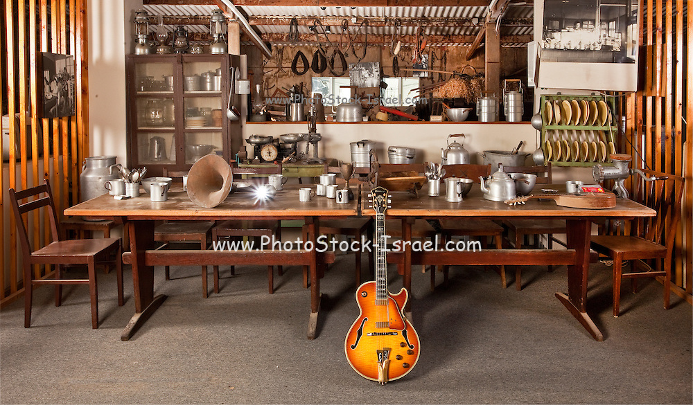 Old style scene with dining room table and guitar