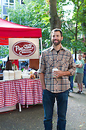 Pine State Biscuits in Portland, OR at the Saturday Farmers' Market in the South Park Blocks in Portland State University's Campus.  Pictured is Brian Snyder, one of three of the owners.