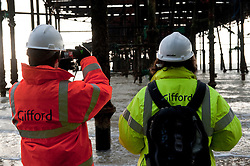 ©London News Pictures. 10/12/2010. Structural Engineers inspect the structure of Hastings Pier, East Sussex, as the first phase of the cleanup operation draws to a close. The pier was ravaged by fire in a suspected arson attack on 5th October 2010. The steel structures on the pier have been removed to minimise danger to the public. Photo credit should read Paul Steven Kelly/London News Pictures.