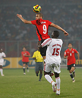 Photo: Steve Bond/Richard Lane Photography.<br />Egypt v Sudan. Africa Cup of Nations. 26/01/2008. Mohamed Zidan gets to the ball above Amir Damar