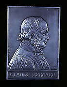 Claude Bernard, 19th century French physiologist, 1913. Obverse of a silver plaquette commemorating the centenary of his birth. Bernard (1813-1878) investigated the liver, discovering glycogen, and determined that most of the process of digestion occurs in the small intestine, rather that the stomach. He showed that haemoglobin carries oxygen in red blood cells, and demonstated how carbon monoxide poisoning disrupted this process. When Bernard died in 1878, the French government organised his funeral, making him the first French scientist to be honoured in this way.