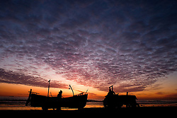 © Licensed to London News Pictures. <br /> 08/05/2015. <br /> <br /> Redcar, United Kingdom<br /> <br /> Fishermen from Redcar launch their boat as the sun comes up over the coast.<br /> <br /> <br /> Photo credit : Ian Forsyth/LNP