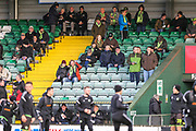 Forest Green Rovers fans watching the players warm up during the EFL Sky Bet League 2 match between Yeovil Town and Forest Green Rovers at Huish Park, Yeovil, England on 8 December 2018.