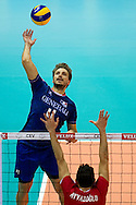 (L) Antonin Rouzier from France attacks the ball against (R) Can Ayvazoglu from Turkey during the 2013 CEV VELUX Volleyball European Championship match between France and Turkey at Ergo Arena in Gdansk on September 22, 2013.<br /> <br /> Poland, Gdansk, September 22, 2013<br /> <br /> Picture also available in RAW (NEF) or TIFF format on special request.<br /> <br /> For editorial use only. Any commercial or promotional use requires permission.<br /> <br /> Mandatory credit:<br /> Photo by © Adam Nurkiewicz / Mediasport