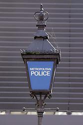 Traditional Metropolitan Police lamp outside Kingston Upon Thames police station; Surrey UK