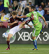 COMMERCE CITY, CO  - MAY 29 :  Wells Thompson #15 of the Colorado Rapids and Patrick Ianni #4 of the Seattle Sounders FC battle for a loose ball during the first half at Dick's Sporting Goods Park in Commerce City, Colorado on Sunday May 29, 2010.(Photo by Marc Piscotty/ © 2010)