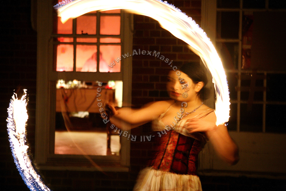 Nozemi, 18, is playing with a flaming stick in the back of the Ingram Avenue mansion during a party on Saturday, Oct. 20, 2007, in Hampstead, London, England. The 22-room mansion was last sold for UK£ 3.9M in 2002 and is now awaiting planning permissions to be demolished. Two new houses will soon be taking its place. Million Dollar Squatters is a documentary project in the lives of a peculiar group of squatters residing in three multi-million mansions in one of the classiest residential neighbourhoods of London, Hampstead Garden. The squatters' enthusiasm, their constant efforts to look after what has become their home, their ingenuity and adventurous spirit have all inspired me throughout the days and nights spent at their side. Between the fantasy world of exclusive Britain and the reality of squatting in London, I have been a witness to their unique story. While more than 100.000 properties in London still lay empty to this day, squatting provides a valid, and lawful alternative to paying Europe's most expensive rent prices, as well as offering the challenge of an adventurous lifestyle in the capital.