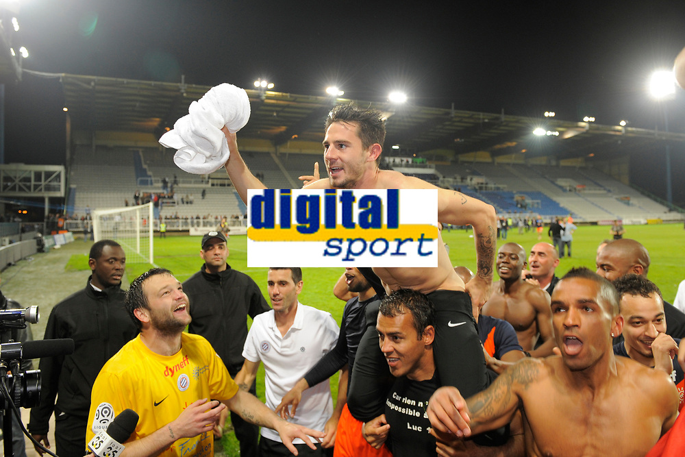 FOOTBALL - FRENCH CHAMPIONSHIP 2011/2012 - L1 - AJ AUXERRE v MONTPELLIER HSC - 20/05/2012 - PHOTO JEAN MARIE HERVIO / DPPI - CELEBRATION GREGORY LACOMBE / GEOFFREY JOURDREN / HILTON / JORIS MARVEAUX (MHSC) AFTER WINNING THE FRENCH CHAMPIONSHIP'S TROPHY