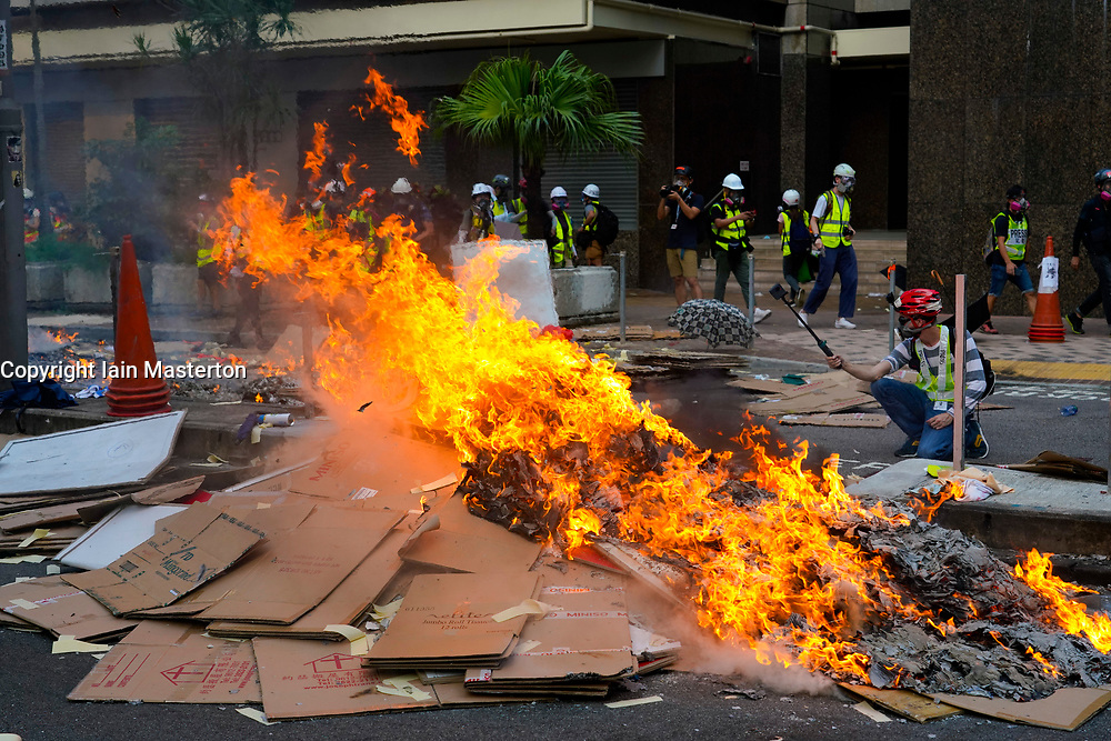 Hong Kong. 1 October 2019. After a peaceful march through Hong Kong Island by an estimated 100,000 pro democracy supporters, violent flared up at Tamar, Admiralty and moved through Wanchai district. Police used teargas and baton rounds and water cannon. Hard core group lit fires, threw bricks and Molotov cocktails at police. Violence continues into evening. Fires set in Queensway business district. Iain Masterton/Alamy Live News.
