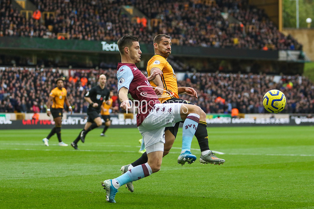 Frederic Guilbert of Aston Villa & Diogo Jota of Wolverhampton Wanderers during the Premier League match between Wolverhampton Wanderers and Aston Villa at Molineux, Wolverhampton, England on 10 November 2019.