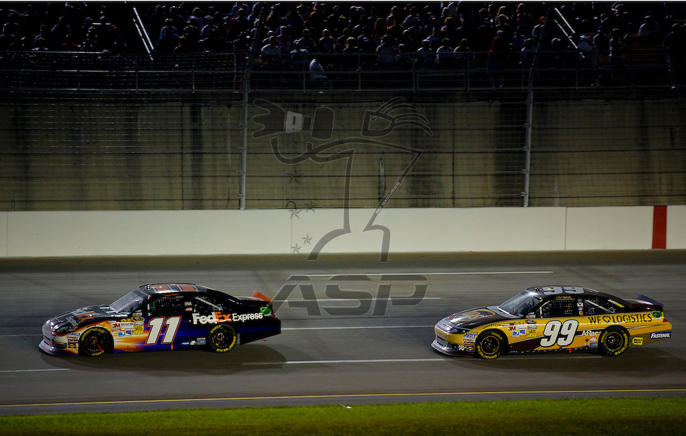 Sparta, KY - JUN 30, 2012: Denny Hamlin (11) and Carl Edwards (99) during the Quaker State 400 at  Kentucky Speedway in Sparta, KY.