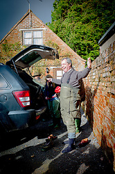 UKIP Leader Nigel Farage puts his waders on in  Burrowbridge, Somerset, United Kingdom. Sunday, 9th February 2014. Somerset has been flooded since the start of 2014, with people being forced to leave their homes. Picture by Andrew Parsons / i-Images