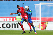 Wigan Athletic defender Cheyenne Dunkley (22) tackles Nottingham Forest forward Sammy Ameobi (19)  during the EFL Sky Bet Championship match between Wigan Athletic and Nottingham Forest at the DW Stadium, Wigan, England on 20 October 2019.