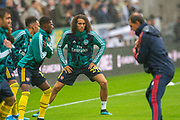 Matteo Guendouzi (#29) of Arsenal FC warms up with team mates before the Premier League match between Newcastle United and Arsenal at St. James's Park, Newcastle, England on 11 August 2019.