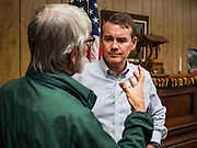 05 MAY 2019 - MADRID, IOWA: US Senator MICHAEL BENNET (D-CO), talks to a member of the Boone County Democrats after a campaign stop in Madrid, IA., about 45 minutes north of Des Moines. Sen. Bennet is running for the Democratic nomination for the US Presidency in the 2020 election, he declared his candidacy last week and joins a crowded field of over 20 candidates. Iowa traditionally hosts the the first election event of the presidential election cycle. The Iowa Caucuses will be on Feb. 3, 2020.        PHOTO BY JACK KURTZ