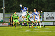 Cheltenham Town's Danny Whitehead heads away an early Forest Green corner during the Gloucestershire Senior Cup match between Forest Green Rovers and Cheltenham Town at the New Lawn, Forest Green, United Kingdom on 20 September 2016. Photo by Shane Healey.