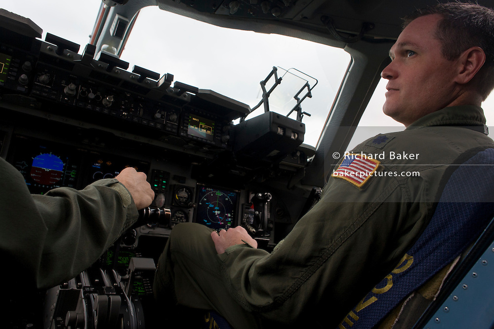 Pilots of the US Air Force in the cockpit of a C-17 transport jet at the Farnborough Air Show, UK.
