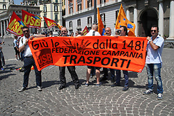 June 26, 2017 - Napoli, Campania/Napoli, Italy - ANM Napoli protests in front of the Prefecture.''Negato il diritto di sciopero''. ''La 148 non si tocca'', this is written on one of the posters that the employees of the ANM have exposed during the sit-in before the Prefecture of Naples. Workers are worried about the repeal of the decree governing the auto-transporters sector. (Credit Image: © Salvatore Esposito/Pacific Press via ZUMA Wire)