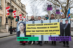 London, UK. 19th January, 2019. Members of the Kurdish community march from Trafalgar Square to Parliament Square in support of jailed Kurdish politician Leyla Güven and her fellow hunger striking prisoners Esat Naci Yıldırım and Kadir Karabak.