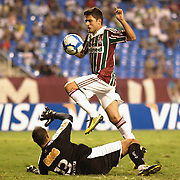 Marquinhos of Fluminense lifts the ball over Atletico MG goalkeeper Fabio Costa to score his sides fifth goal during the  Fluminense VAtlético MG, Futebol Brasileirao  League match at Estadio Olímpico Joao Havelange, Rio de Janeiro, Fluminense won the match 5-1. Rio de Janeiro,  Brazil. 23rd September 2010. Photo Tim Clayton.